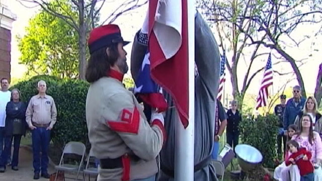 PHOTO Confederate Flag Causes Controversy People are divided over the raising of the flag over a Texas courthouse.