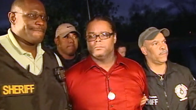 PHOTO: Lyndon Granger, brother of courthouse shooting suspect Bartholomew Granger, is arrested during a Houston news conference about the shooting.