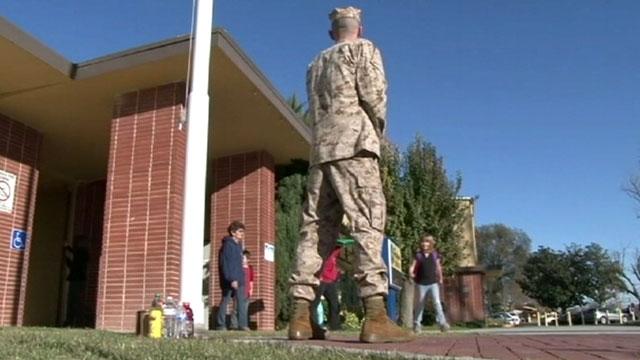 PHOTO: Marine Sgt. Craig Pusley stood outside of Hughson Elementary School in Hughson, Calif.