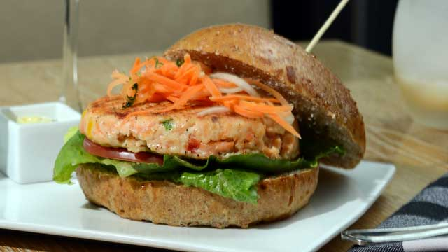 PHOTO: The Salmon burger is a healthier option served at Marx restaurant with a side salad and Apple Martini, July 20, 2012.