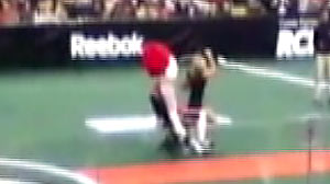 """PHOTO the Boston Blazers mascot, Scorch, sat down in a chair on the field. Shortly thereafter Scorch was approached by several scantily clad """"fans"""" who proceeded to give him a lap dance"""