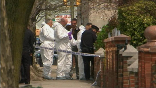 PHOTO: New York Police investigate the scene in the East Flatbush section of the New York borough of Brooklyn, where a an off-duty police officer shot her boyfriend, baby and herself to death on April 15, 2013.
