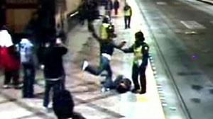 Guards watch as teen is beaten