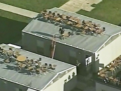 Video: High school prank sends chairs flying.