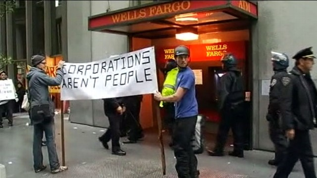 VIDEO: Activists clash with police as they protest against the bank and foreclosures.