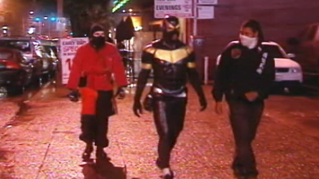 """PHOTO:""""Phoenix Jones"""", center, was arrested, Oct. 9, 2011, for investigation of assault in Seattle."""