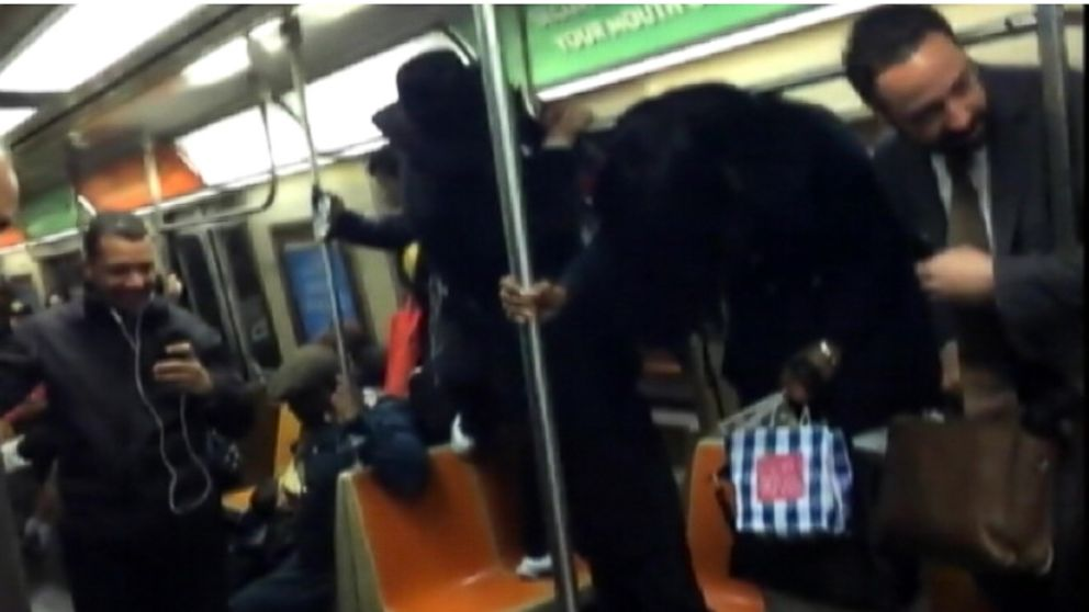 VIDEO: Commuters scream and stand on their seats while riding on a train bound for Brooklyn.