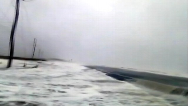 VIDEO: Storm surge in Rodanthe, N.c., floods roadway and homes.