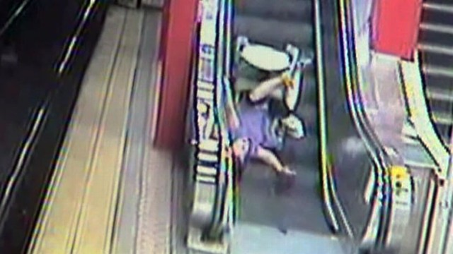 VIDEO: The 56-year-old woman in Boston walked away after tumbling on an escalator.