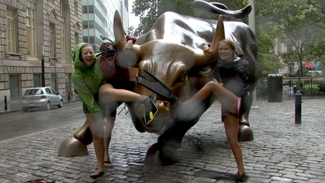 PHOTO:Alex Libby, Hannah Gabelmann and Janna Libby decided to survey the extent of Hurricane Irene?s fury by walking through lower Manhattan in scuba gear.