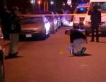 PHOTO: Police investigate the scene where four people were set on fire in Denver, Colo., Dec. 13, 2012.