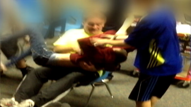 PHOTO: A video of Karla Kinneys 13-year-old son being dragged across the classroom by teacher and fellow student.