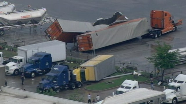 VIDEO: Flattened and crumpled trailers litter the area in the aftermath of twisters.