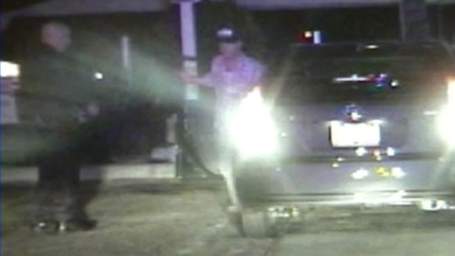 VIDEO: A suspected drunk driver loses control of his car during police stop.