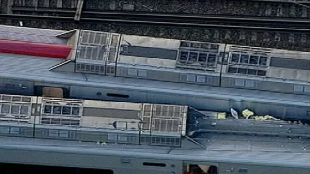 VIDEO: An eastbound train derailed and crashed into a westbound train.