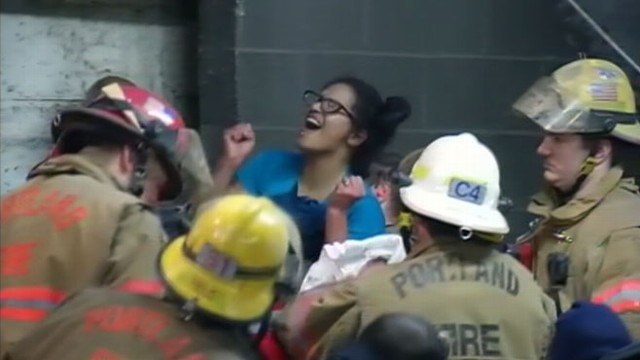 VIDEO: The woman was wedged for hours between a building and a cinder block wall.