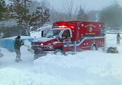 VIDEO: Residents in Massachusetts help an ambulance that got stuck in the snow.