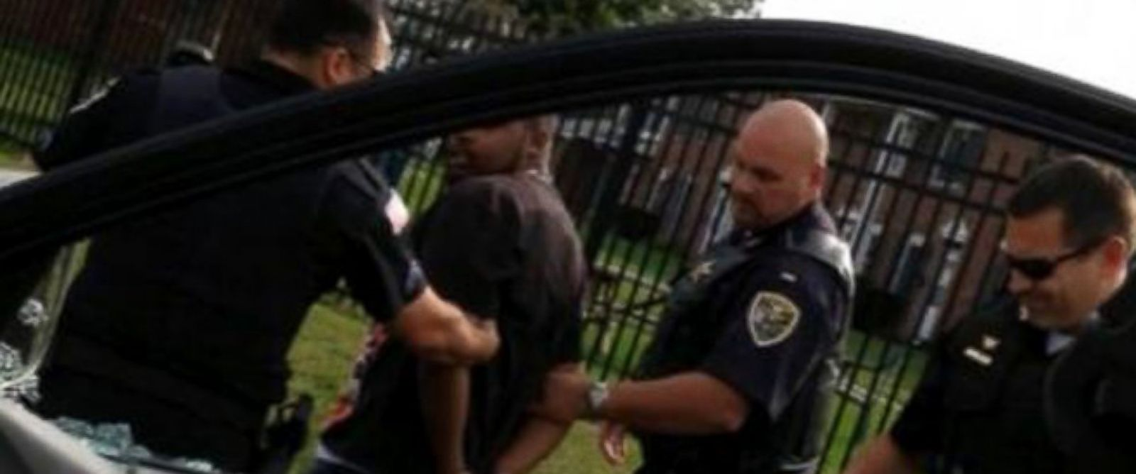 PHOTO: A grab from a video showing Jamal Jones being detained during a routine traffic stop. The family is suing the police department for excessive force after an officer smashed a car window.