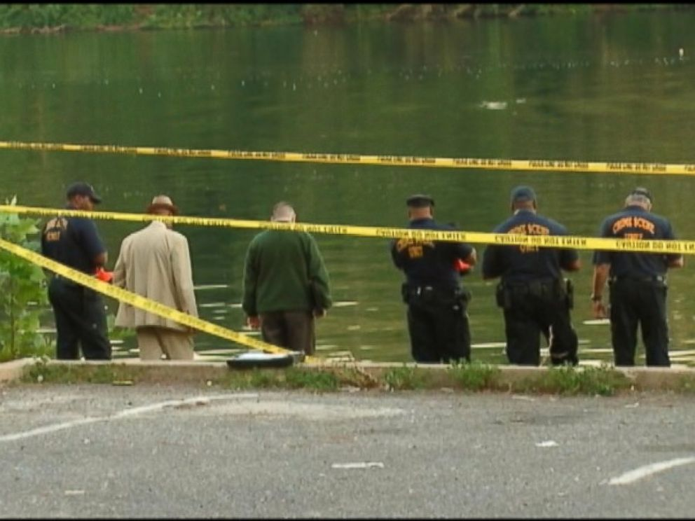 PHOTO: Local police on the edge of the Schuylkill River in Philadelphia, Pa. where a double homicide occurred on Aug. 27, 2014.