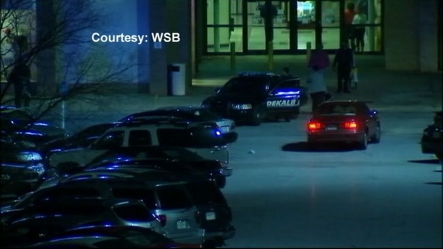 VIDEO: Holiday shoppers startled after gun shots go off in mall parking lot.