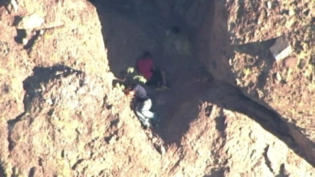 VIDEO: Arizona firefighters rescued two hikers after a third fell 150 feet trying to escape a swarm of bees.