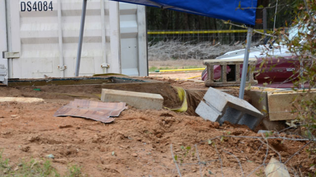 PHOTO: In this undated photo released by the FBI on Tuesday, Feb. 5, 2013, a tent covers the bunker where where a 5-year-old child was held for a week by Jimmy Lee Dykes in Midland City, Ala.