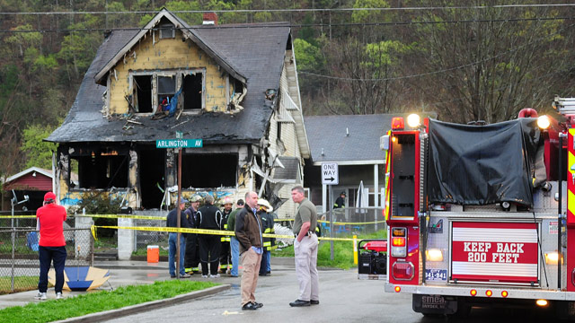 PHOTO: Firefighters and city officials look over the scene of a house fire on Saturday, March 24, 2012, in Charleston, in this photo provided by Jerry Waters.