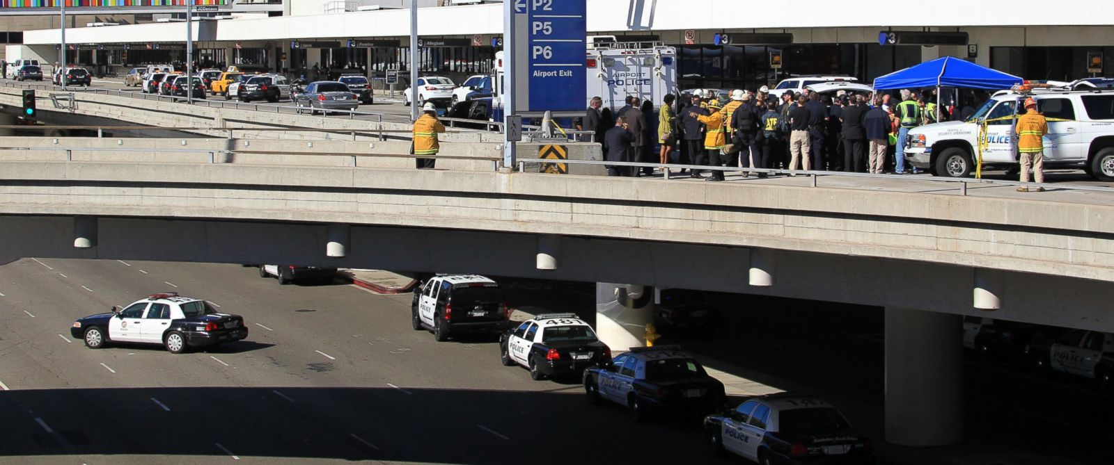 PHOTO: Police, emergency response vehicles and officials are positioned outside Terminal 3 at Los Angeles International Airport on Nov. 1, 2013 where shots were fired, prompting authorities to evacuate a terminal and stop flights.