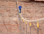 PHOTO:In this photo provided by the Discovery Channel, aerialist Nik Wallenda walks a 2-inch-thick steel cable taking him a quarter mile over the Little Colorado River Gorge, Ariz. on Sunday, June 23, 2013.