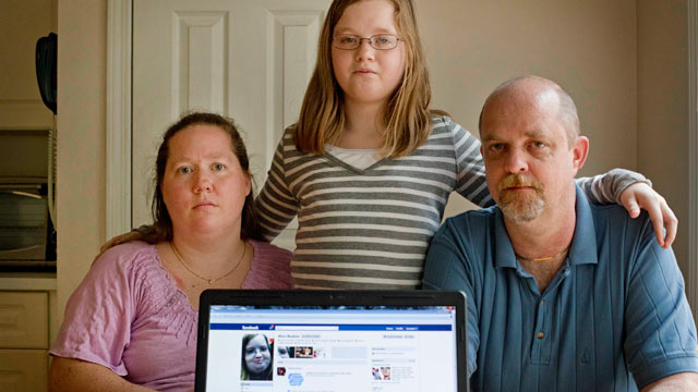 PHOTO: Alex Boston, 14, center, poses with her mom Amy, and father Chris and a screen shot of the phony Facebook account that was set up in Alexs name, April 26, 2012, at their home in Acworth, Ga.