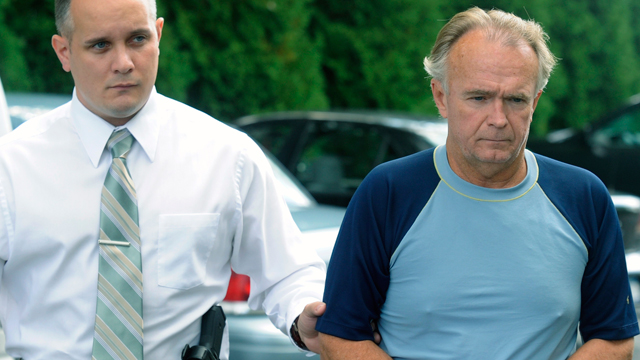 PHOTO: The Rev. Arthur Burton Schirmer, 62, right, is led into district court by Pennsylvania State Trooper Bill Skotleski in Tannersville, Pa., Sept. 13, 2010.
