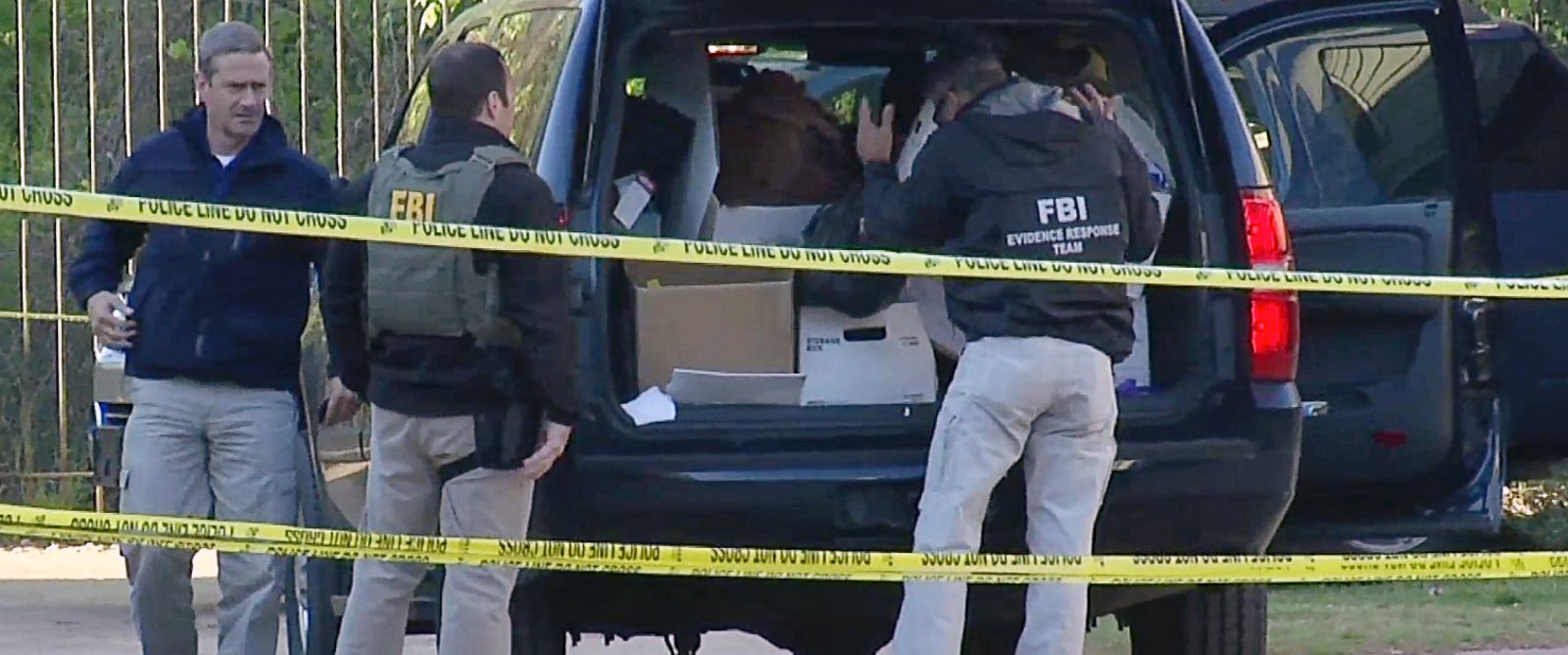 PHOTO: In this photo taken from video, FBI agents collect evidence at an apartment complex on April 10, 2014 in Atlanta where federal agents rescued kidnap victim Frank Arthur Janssen, of Wake Forest. N.C.