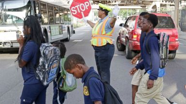 PHOTO: School children walk as crossing guard Patricia Howard stops traffic on Sept. 2, 2014, in Chicago, Ill.