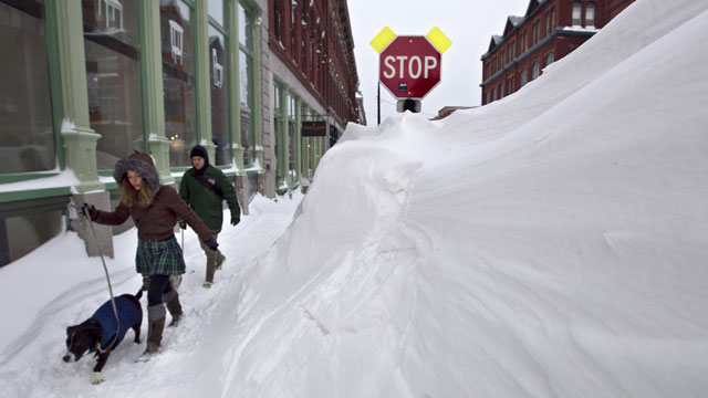 PHOTO:A couple walks past a large snow drift in the Old Port section of Portland, Maine, Feb. 9, 2013. Officials are cautioning residents to stay off the roads in Maine, where Portland set an all-time snowfall record.