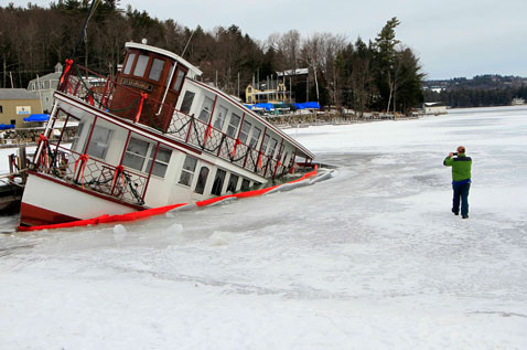ap boat damage Lake Sunapee new hampshire mn thg 130111 wblog Today In Pictures: Hamid Karzai, Sinking Boat, Kate Middleton, and Butterflies
