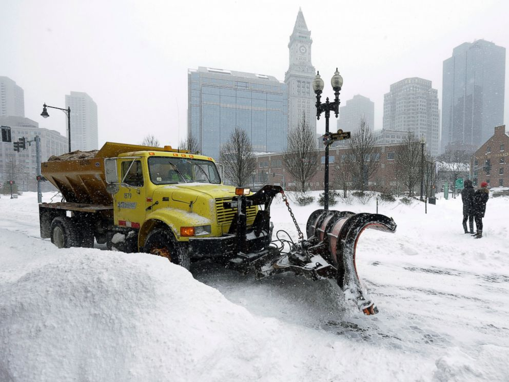 PHOTO: A snowplow clears a street near Quincy Market, on Jan. 27, 2015, in Boston.