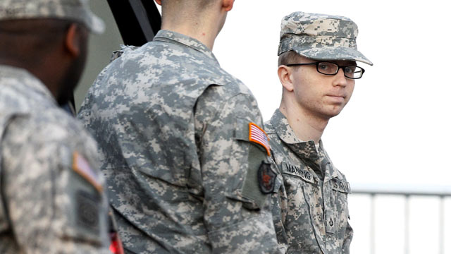 PHOTO: Army Pfc. Bradley Manning, right, is escorted from a security vehicle to a courthouse in Fort Meade, Md., Dec. 22, 2011.