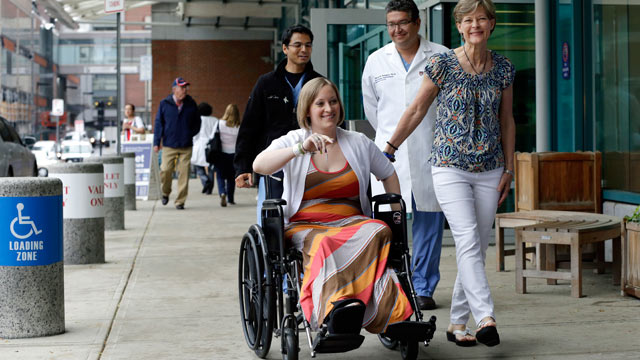 PHOTO: Boston Marathon bombing survivor Erika Brannock, 29, a Baltimore area pre-school teacher who lost a leg, is accompanied by her mother, Carol Downing, right, as she is released from Beth Israel Deaconess Medical Center in Boston, June 3, 2013.