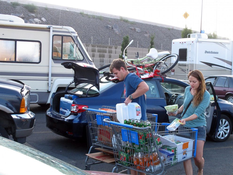 PHOTO: Jeff Difabrizio, left, and Jahliele Paquin of Yellowknife, Canada, load up provisions in the parking lot of a Wal-Mart, Aug. 25, 2014, in Reno, Nev., on their first trek to Burning Man.