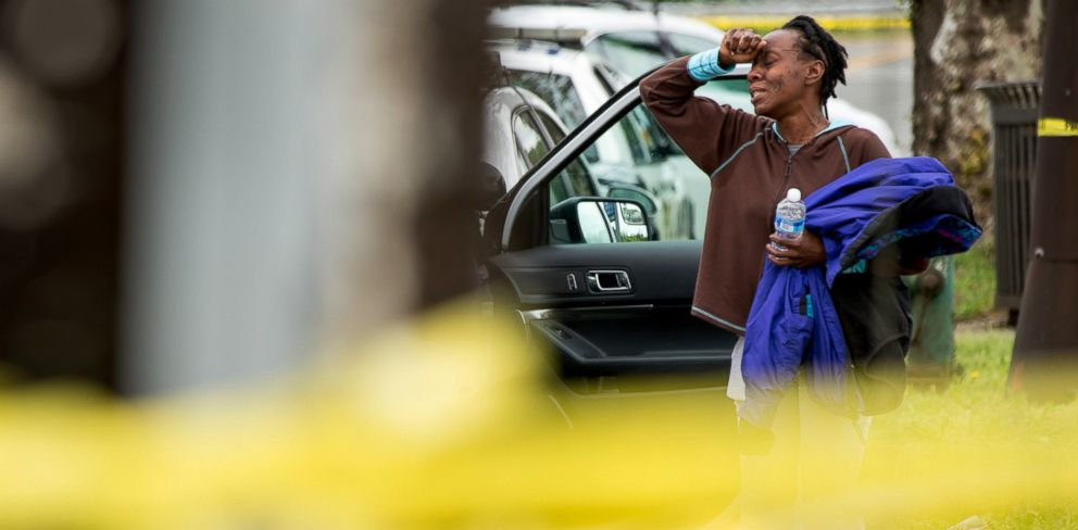 PHOTO: A woman who was said to know a victim is emotional near a crime scene where a man was struck and killed by a stolen bus in Northwest Washington, May 3, 2016.