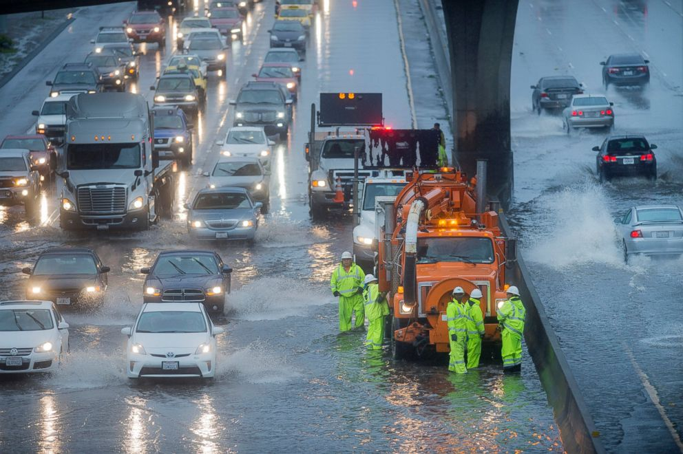 PHOTO: A Caltrans crew tries to clear a flooded stretch of Highway 101 in South San Francisco, Calif., Dec. 11, 2014.