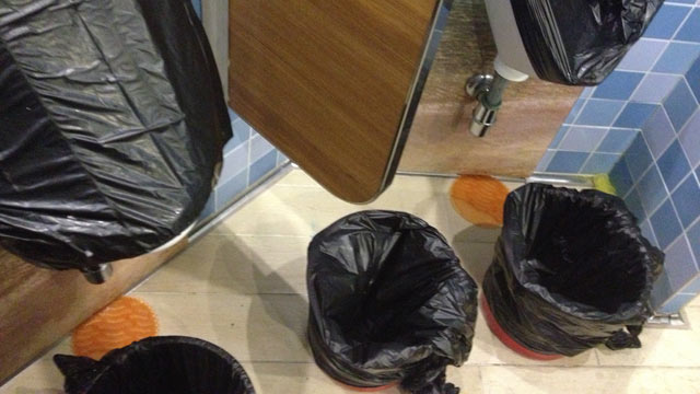 PHOTO: This photo shows covered urinals and bagged trash cans for ...