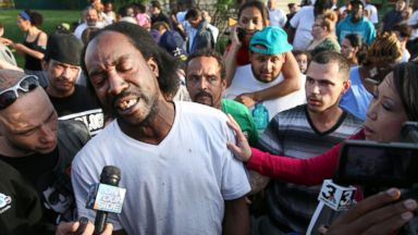 PHOTO: Neighbor Charles Ramsey speaks to media near the home on the 2200 block of Seymour Avenue, where three missing women were rescued in Cleveland, on May 6, 2013.