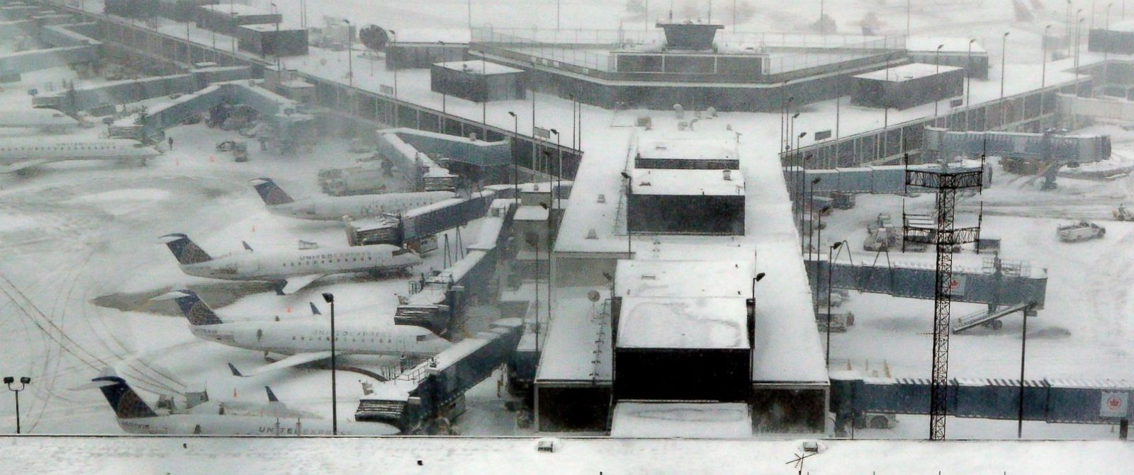 PHOTO: Airplanes stand in the snow at OHare International Airport on Feb. 1, 2015, in Chicago.