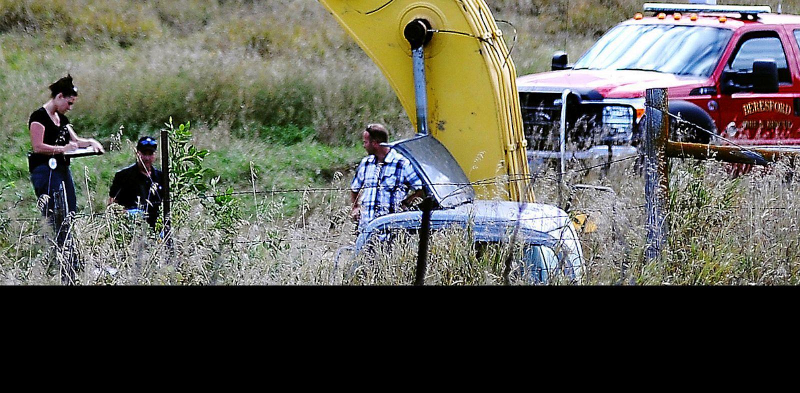 PHOTO: Vehicle being excavated