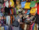 PHOTO: A woman looks through a display of purses on Canal Street in New York, June 4, 2013.