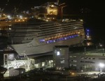 PHOTO: The cruise ship Carnival Triumph is pushed towards the cruise terminal along the Mobile River in Mobile, Ala., Thursday, Feb. 14, 2013.