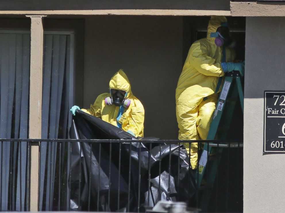 PHOTO: Hazardous material cleaners prepare to hang black plastic outside the apartment in Dallas where Thomas Eric Duncan, the Ebola patient who traveled from Liberia to Dallas stayed last week, Oct. 3, 2014.