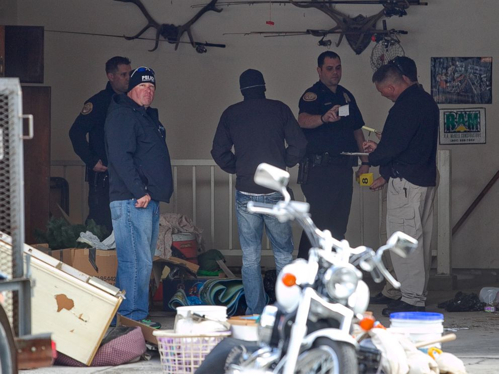 PHOTO: Authorities investigate a crime scene at a house in Pleasant Grove, Utah, Sunday, April 13, 2014. According to the Pleasant Grove Police Department, seven dead infants were found in the former home of Megan Huntsman, 39.