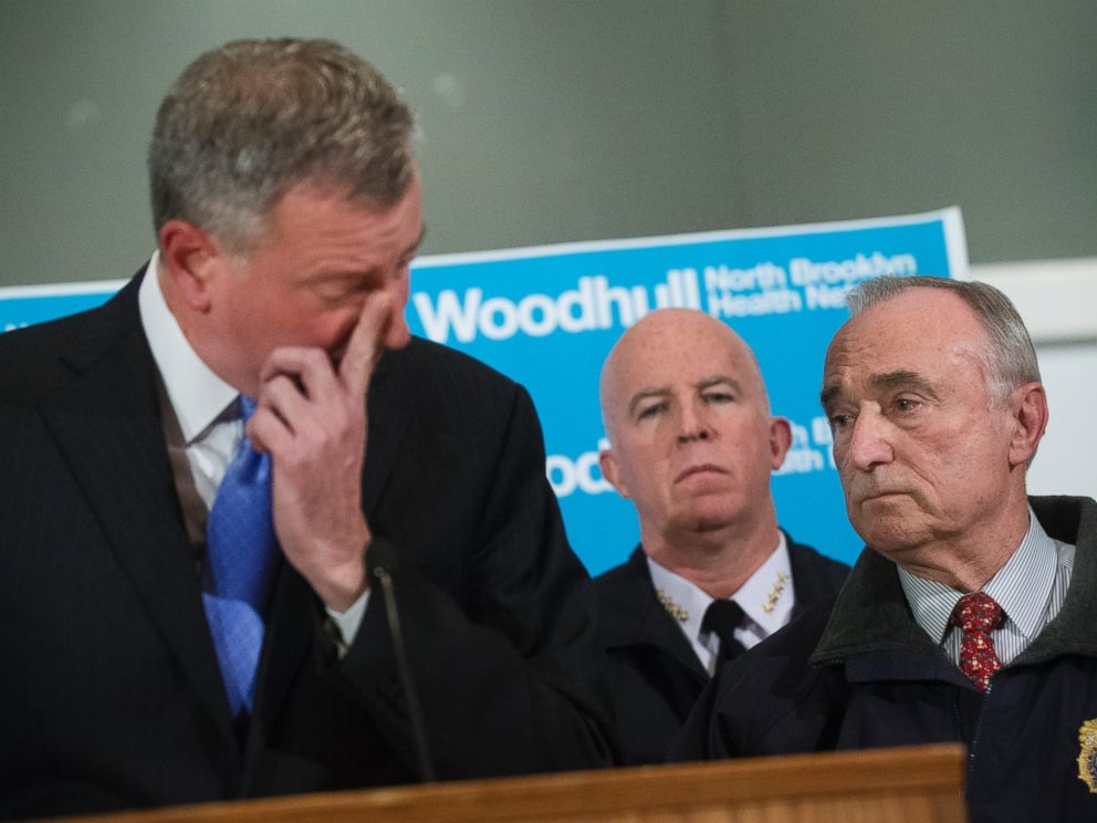 PHOTO: NYPD Commissioner Bill Bratton, right, stands beside Mayor Bill de Blasio as he wipes his eye during a news conference at Woodhull Medical Center, Saturday, Dec. 20, 2014, in New York.